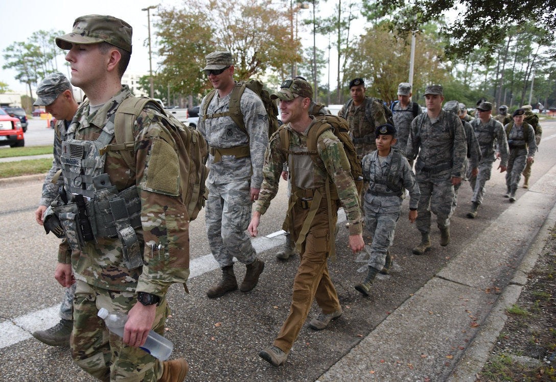 Members of the 81st Security Forces Squadron participate in the 81st SFS Veterans Day Ruck March at Keesler Air Force Base, Mississippi, Nov. 9, 2018. The 6.8 mile ruck march was held in honor of all veterans and victims of war. (U.S. Air Force photo by Kemberly Groue)