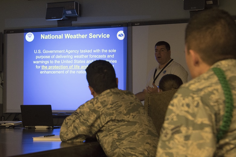 Keesler 335th Training Squadron weather students listen to a SkyWarn Program briefing by Phil Grigsby, National Weather Service forecaster, inside the Weather Training Complex at Keesler Air Force Base, Mississippi, Nov. 2, 2018. The program is a partnership between the National Weather Service and the 81st Training Wing, which certifies the weather students to be official storm spotters. (U.S. Air Force photo by Airman 1st Class Suzie Plotnikov)