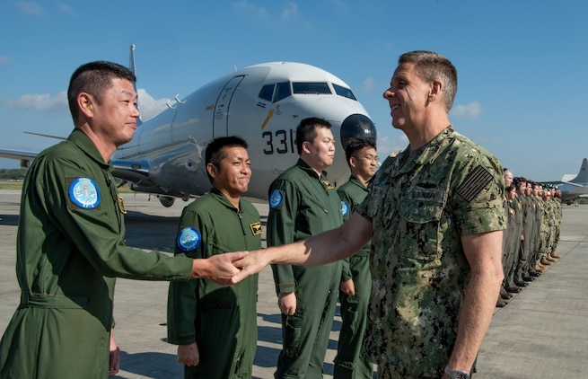U.S. Navy Adm. Phil Davidson, commander of U.S. Indo-Pacific Command, greets aircrews at Kadena Air Base Nov. 7, 2018.