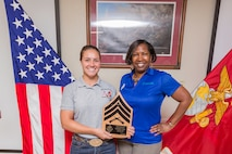 Sergeant Emily Rowe, Mounted Color Guard Horseman, receives the NCO of the Quarter award for the third quarter from Stacey McCray, Pacific Marine Credit Union, during the Quarterly Awards Breakfast aboard Marine Corps Logistics Base Barstow, Calif., Oct. 30.