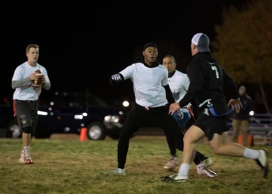 Airman 1st Class Joshua Robertson, SF Sykes lineman, blocks rushers from SF Stankiewicz during the 2018 intramural flag football championship at Kirtland Air Force Base, N.M., Nov. 8. (U.S. Air Force photo by Staff Sgt. J.D. Strong II)