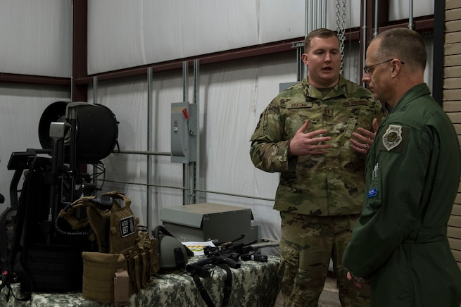 U.S. Air Force Capt. Nathan Bratka, operations officer assigned to the 97th Security Forces Squadron, showcases the equipment used by the emergency service team for the 97th SFS to Maj. Gen. Mark Weatherington, Air Education and Training Command deputy commander, Nov. 8, 2018, at Altus Air Force Base, Okla. Several squadrons across the 97th Air Mobility Wing showcased their capabilities to Weatherington to highlight their innovations and progress with training. (U.S. Air Force photo by Senior Airman Cody Dowell)