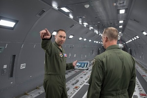 U.S. Air Force Tech. Sgt. Dustan Foret, NCO in charge of the KC-46 Pegasus aircrew training systems assigned the 97th Training Squadron, shows Maj. Gen. Mark Weatherington, Air Education and Training Command deputy commander, the inner workings of the KC-46 Fuselage Trainer, Nov. 8, 2018, at Altus Air Force Base, Okla. The fuselage was part of the tour for Weatherington to see the capabilities that the base has for the arrival of the KC-46 aircraft. (U.S. Air Force photo by Senior Airman Cody Dowell)