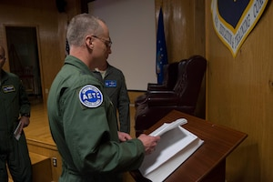 U.S. Air Force Maj. Gen. Mark Weatherington, Air Education and Training Command deputy commander, looks through the boom operator heritage book, Nov. 8, 2018, at Altus Air Force Base, Okla. The book contains the signatures of boom operators that have graduated from the formal training unit. (U.S. Air Force photo by Senior Airman Cody Dowell)