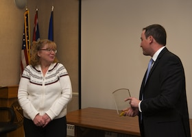 Award winner Sandra Rutherford, 90th Contracting Squadron director of business operations, is presented the Small Business Advocate of the Year award for the State of Wyoming, by Dan Nordberg, U.S. Small Business Administration Region VIII administrator Nov. 7, 2018, at F.E. Warren Air Force Base, Wyo. The award recognizes individuals who have provided exceptional services to small businesses. Rutherford sought out opportunities and ensured openings were offered to women and veteran owned firms and small businesses. (U.S. Air Force photo by Senior Airman Ashley N. Sokolov)