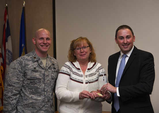 Award winner Sandra Rutherford, 90th Contracting Squadron director of business operations, is presented the Small Business Advocate of the Year award for the State of Wyoming, Nov. 7, 2018, at F.E. Warren Air Force Base, Wyo. The award recognizes individuals who have provided exceptional services to small businesses. Rutherford sought out opportunities and ensured openings were offered to women and veteran owned firms and small businesses. (U.S. Air Force photo by Senior Airman Ashley N. Sokolov)