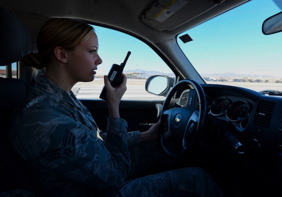 Senior Airman Sierra Rodwick, 57th Operations Support Squadron airfield management shift lead, using a radio to contact the Air Traffic Control Tower Oct. 15, 2018 on Nellis Air Force Base, Nevada. The main responsibility of airfield management shift leads is ensuring the flightline's safety. (U.S. Air Force photo by Airman Bailee A. Darbasie)