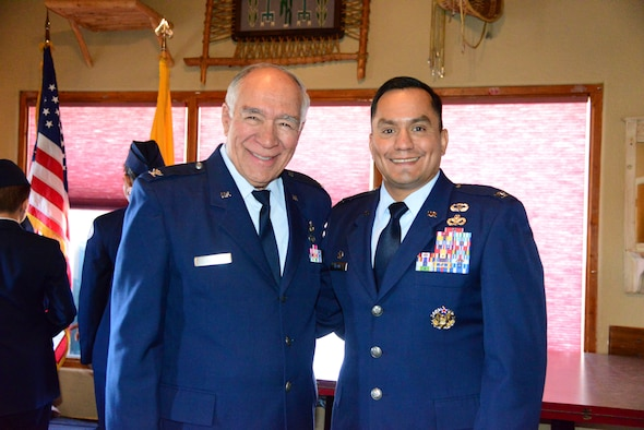 The mayor of Los Ranchos de Albuquerque and retired Air Force Col. Donald T. Lopez (left), poses with Col. Juan Alvarez, 377th Mission Support Group commander, at Sadie's Restaruant in Los Ranchos Oct. 9. Kirtland Airmen attended a luncheon there to honor a group of veterans, and festivities included remarks by Lopez and Alvarez. The event was also supported with a presentation of the colors by the Valley High School JROTC, honoring veterans past and present. (U.S. Air Force photo by Jessie Perkins)