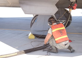 Senior Airman Johnny Cruz, 57th Aircraft Maintenance Squadron Raptor Aircraft Maintenance Unit assistant dedicated crew chief, looks over the fuel line on Nellis Air Force Base, Nevada, Nov. 7, 2018. Refueling times can be reduced significantly when the aircraft keeps their engines on. (U.S. Air Force photo by Airman 1st Class Bryan T. Guthrie)