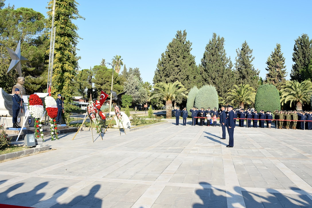 U.S. Air Force, Turkish Air Force and Spanish Army service members render salutes to a memorial of Ataturk during the Ataturk Memorial Day ceremony, Nov. 10, 2018, at Incirlik Air Base, Turkey.