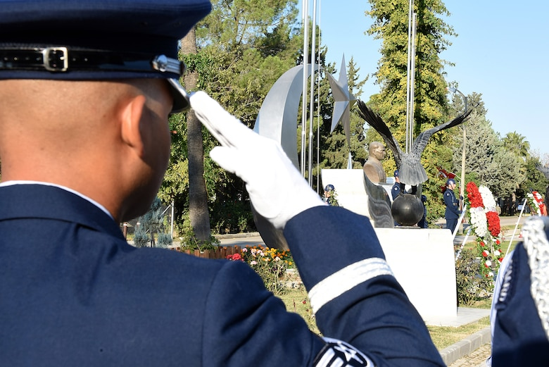 An Incirlik Air Base Honor Guard member salutes during an annual Ataturk Day Memorial service held in front of the 10th Tanker Commander Headquarters building at Incirlik AB, Turkey, Nov. 10, 2018.