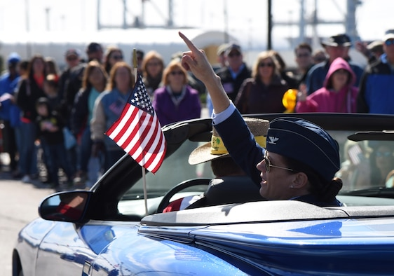 U.S. Air Force Col. Marcia Quigley, 81st Mission Support Group commander, tosses doubloons to the crowd during the 18th Annual Gulf Coast Veterans Day Parade in Gulfport, Mississippi, Nov. 10, 2018. Keesler Air Force Base leadership along with hundreds of Airmen attended and participated in the parade in support of all veterans past and present. More than 70 unique floats, marching bands and military units marched in the largest Veterans Day parade on the Gulf Coast. (U.S. Air Force photo by Kemberly Groue)