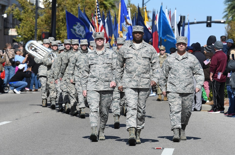 U.S. Air Force Lt. Col. Michael Manning, 81st Training Group deputy commander, Col. Leo Lawson Jr., 81st TRG commander, and Chief Master Sgt. Anthony Fisher, 81st TRG superintendent, march in the 18th Annual Gulf Coast Veterans Day Parade in Gulfport, Mississippi, Nov. 10, 2018. Keesler Air Force Base leadership along with hundreds of Airmen attended and participated in the parade in support of all veterans past and present. More than 70 unique floats, marching bands and military units marched in the largest Veterans Day parade on the Gulf Coast. (U.S. Air Force photo by Kemberly Groue)