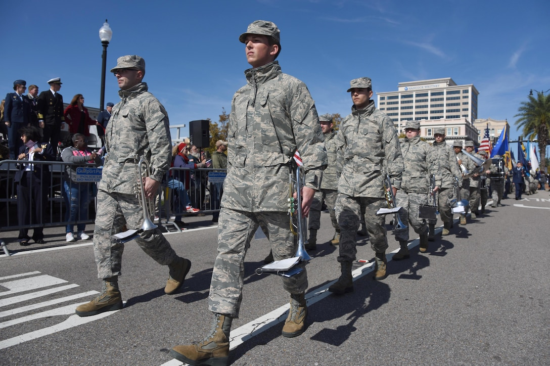 Airmen from the 81st Training Group march in formation during the Mississippi Gulf Coast Veterans Parade in Gulfport, Mississippi, Nov. 10, 2018. Keesler Air Force Base leadership along with hundreds of Airmen attended and participated in the parade in support of all veterans past and present. Approximately 100 unique floats, marching bands and military units marched in the largest Veterans Day parade on the Gulf Coast. (U.S. Air Force photo by Kemberly Groue)