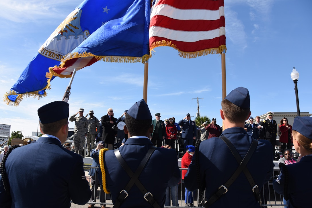 The Keesler Honor Guard presents the colors during the Mississippi Gulf Coast Veterans Parade in Gulfport, Mississippi, Nov. 10, 2018. Keesler Air Force Base leadership along with hundreds of Airmen attended and participated in the parade in support of all veterans past and present. More than 70 unique floats, marching bands and military units marched in the largest Veterans Day parade on the Gulf Coast. (U.S. Air Force photo by Kemberly Groue)