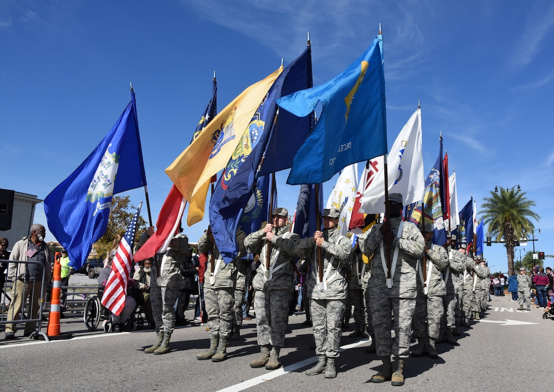 Airmen from the 81st Training Group carrying the 50 state flags march in the 18th Annual Gulf Coast Veterans Day Parade in Gulfport, Mississippi, Nov. 10, 2018. Keesler Air Force Base leadership along with hundreds of Airmen attended and participated in the parade in support of all veterans past and present. More than 70 unique floats, marching bands and military units marched in the largest Veterans Day parade on the Gulf Coast. (U.S. Air Force photo by Kemberly Groue)