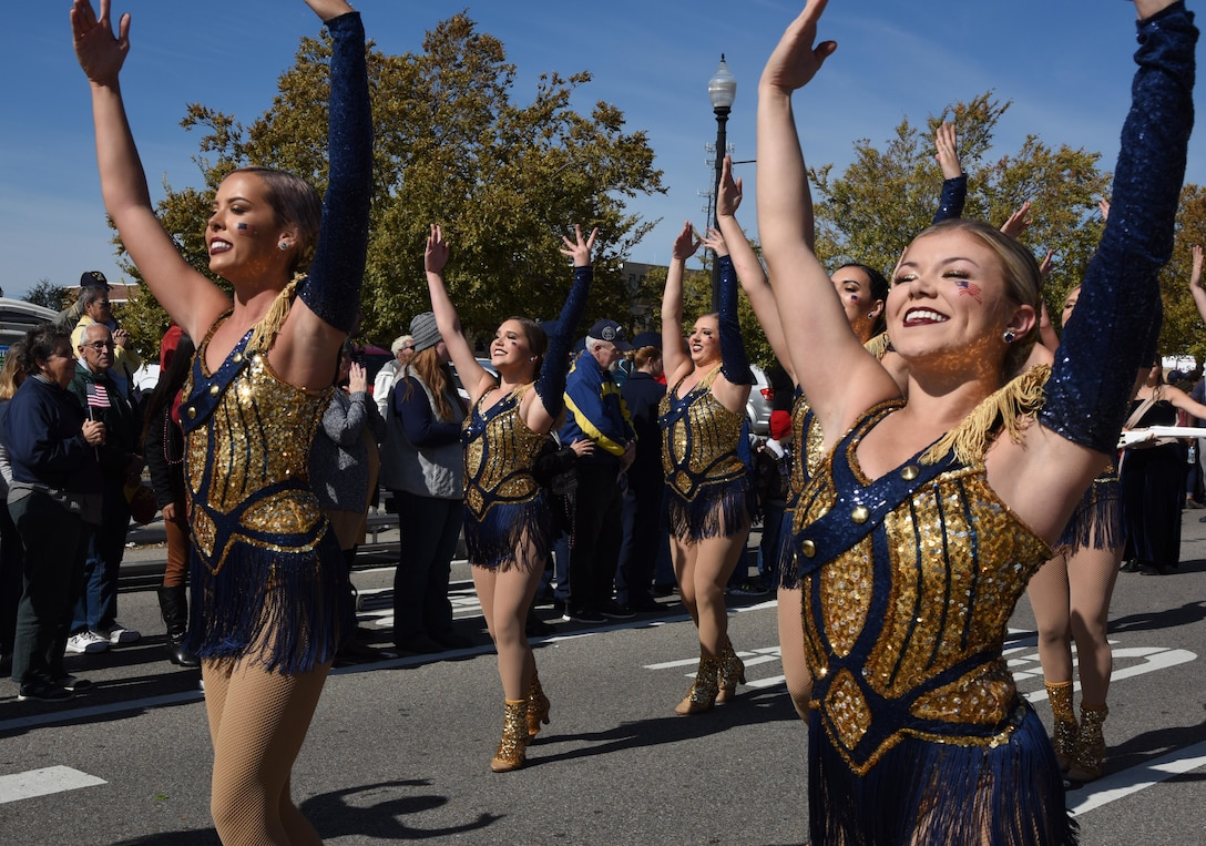 The Mississippi Gulf Coast Community College Perkettes perform during the 18th Annual Gulf Coast Veterans Day Parade in Gulfport, Mississippi, Nov. 10, 2018. Keesler Air Force Base leadership along with hundreds of Airmen attended and participated in the parade in support of all veterans past and present. More than 70 unique floats, marching bands and military units marched in the largest Veterans Day parade on the Gulf Coast. (U.S. Air Force photo by Kemberly Groue)