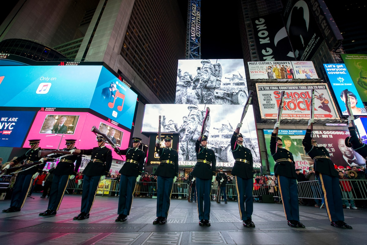 The U.S. Army drill team performs rifle drills at an exhibition in Times Square in New York.