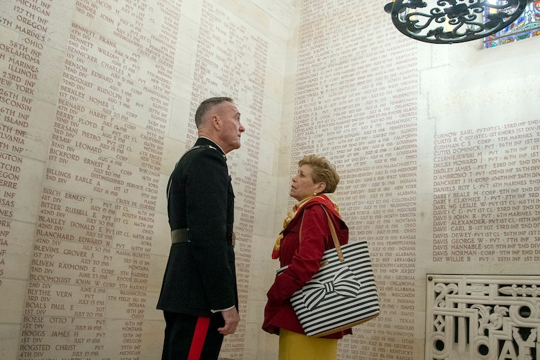 Marine Corps Gen. Joe Dunford, chairman of the Joint Chiefs of Staff, and his wife, Ellyn, read names on a wall in a chapel.