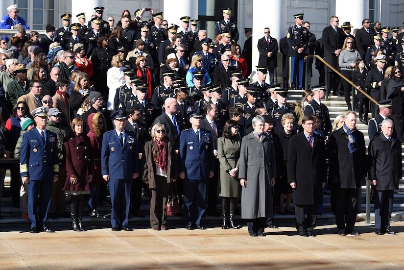Defense Secretary James N. Mattis and Deputy Defense Secretary Patrick M. Shanahan stand with military leaders at Arlington Nationial Cemetery