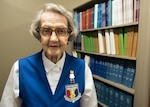 Helen Wells, a 94-year-old assistant library volunteer for the 59th Medical Wing, poses for a photo in the Wilford Hall Ambulatory Surgical Center medical library. Wells has dedicated more than 50 years of service to the United States Air Force. (U.S. Air Force photo by Staff Sgt. Kevin Iinuma)
