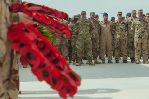 Service members stand in a multinational formation during a Service of Remembrance Nov. 11, 2018, at Al Udeid Air Base, Qatar. Members of the Royal Air Force hosted the event, organizing the involvement of 15 nations' military members. The service marked 100 years since the end of World War I. (U.S. Air Force photo by Tech. Sgt. Christopher Hubenthal)