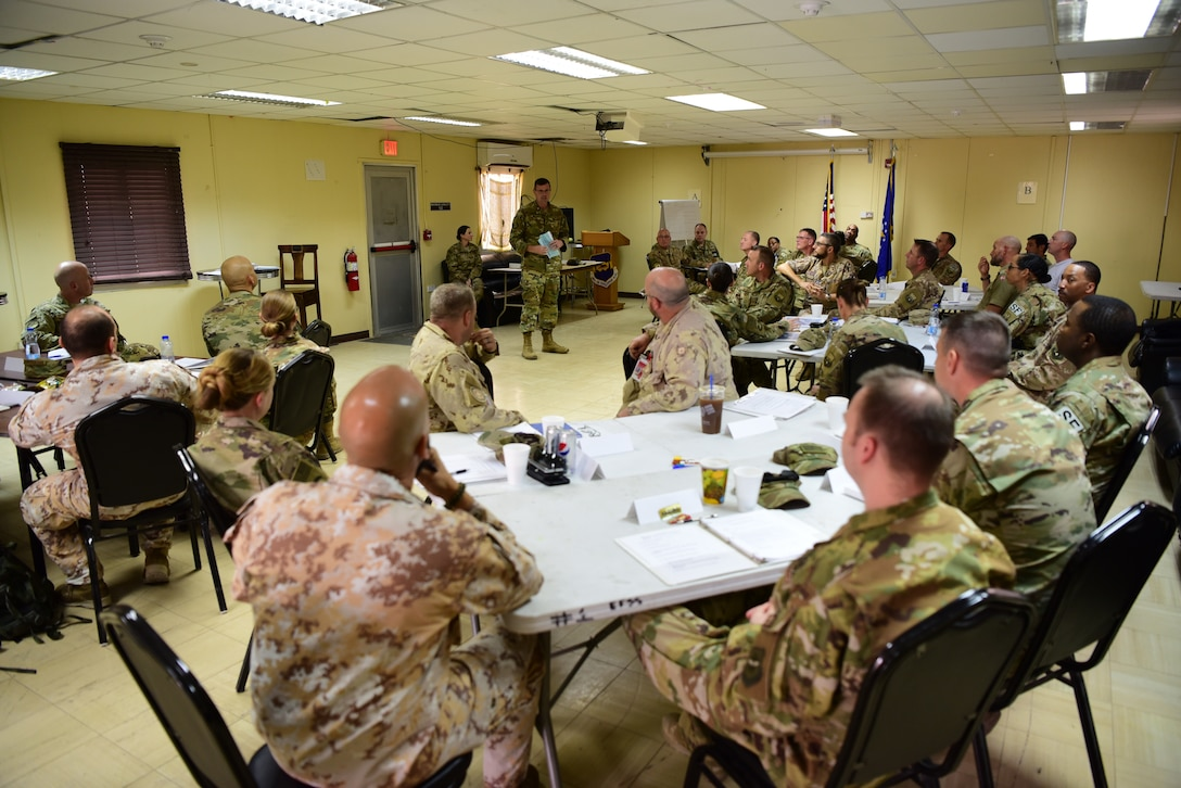 Chief Master Sgt. Chad Welch, 386th Air Expeditionary Wing command chief, speaks to students of the senior non-commissioned officer leadership course Nov. 2, 2018, at an undisclosed location in Southwest Asia. This marked the first time the SNCOLC was hosted in a deployed environment, and the first time it has ever been offered to coalition partners. (U.S. Air Force photo by Staff Sgt. Christopher Stoltz)