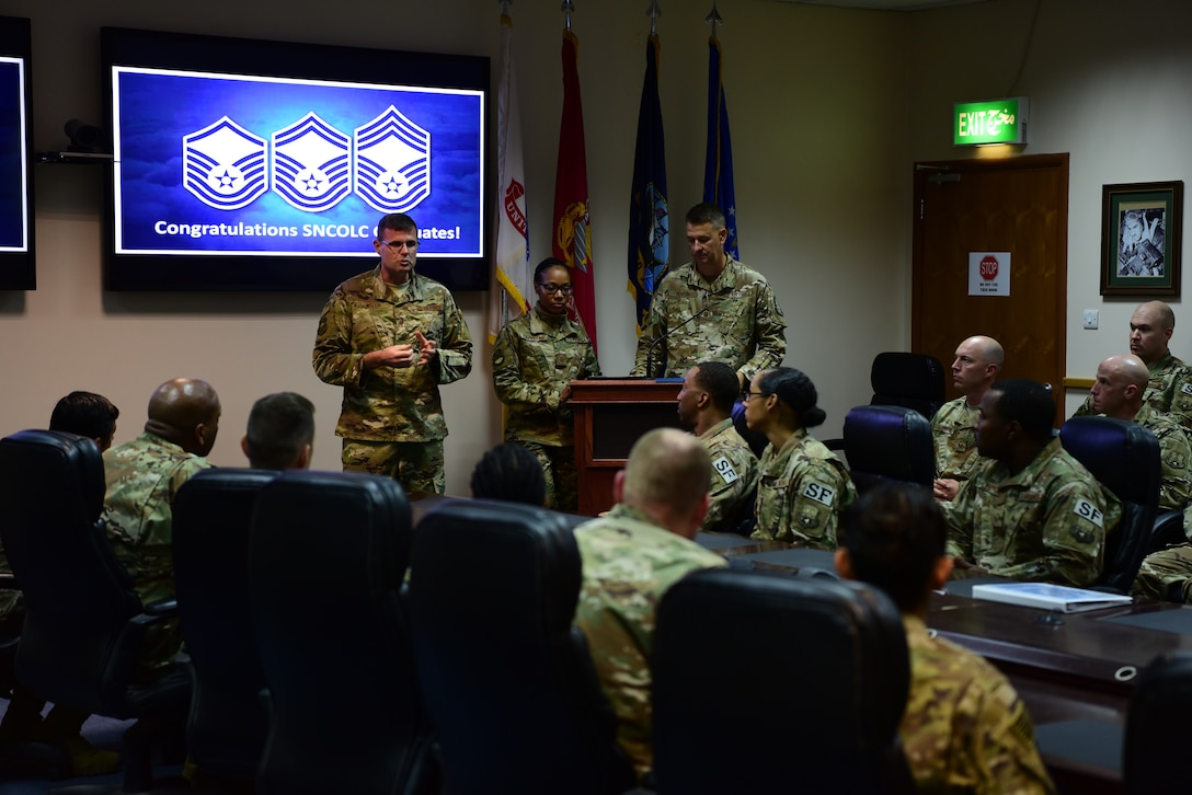 Chief Master Sgt. Chad Welch, 386th Air Expeditionary Wing command chief, speaks to graduates of the senior non-commissioned officer leadership course Nov. 3, 2018, at an undisclosed location in Southwest Asia. The course provided attendees the opportunity to explore in-depth communications, trust, teamwork and leadership proficiencies. (U.S. Air Force photo by Staff Sgt. Christopher Stoltz)