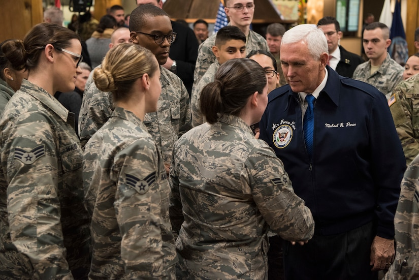 The vice president shakes hands with service members.