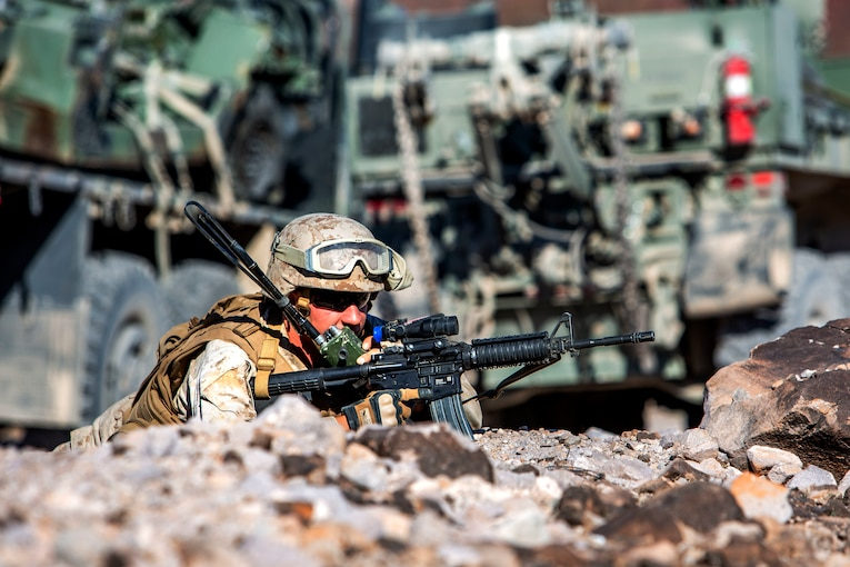 A soldier on the ground holding a weapon