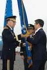 Jeon Kyeog-Doo, Minister of National Defense, Republic of Korea and Gen. Robert B. Abrams participate in the passing of the Combined Forces Command colors with the Ground Component Command Senior Enlisted Advisor, Command Sgt. Maj. Kim, Joo sik.