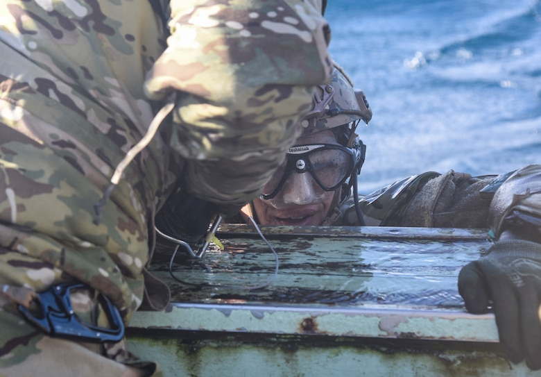 A U.S. Air Force pararescue specialist with the 31st Rescue Squadron gets pulled onto a Misawa City boat for a combat search and rescue training operation during exercise Keen Sword 19, near Misawa Air Base, Japan, Oct. 31, 2019. Exercises like Keen Sword demonstrate the United States' and Japan's strong commitment to a free and open Indo-Pacific region. The U.S.-Japan mutual security treaty is a symbol of the U.S. commitment to Japan and the region and allows the United States to provide forward-deployed forces that can rapidly respond to counter aggression against Japan and other regional allies and partners. (U.S. Air Force photo by Senior Airman Sadie Colbert)