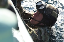 U.S. Air Force Capt. John Krzyminski, a 31st Rescue Squadron combat rescue officer from Kadena Air Base, Japan, grabs a helping hand from a team member for a combat search and rescue training mission during exercise Keen Sword 19, near Misawa Air Base, Japan, Oct. 31, 2019. Keen Sword is the ideal training scenario, allowing Japan Self-Defense Force and U.S. military forces to work together across a variety of areas and enhances the interoperability of U.S. and Japan forces. Exercises like Keen Sword demonstrate the United States' and Japan's strong commitment to a free and open Indo-Pacific region. (U.S. Air Force photo by Senior Airman Sadie Colbert)