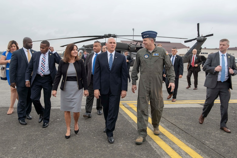 Vice President of the United States Michael R. Pence and his wife, Second Lady Karen Pence, walk with Lt. Gen. Jerry P. Martinez, U.S. Forces Japan and 5th Air Force commander, after arriving at Yokota Air Base, Japan, Nov. 13, 2018.