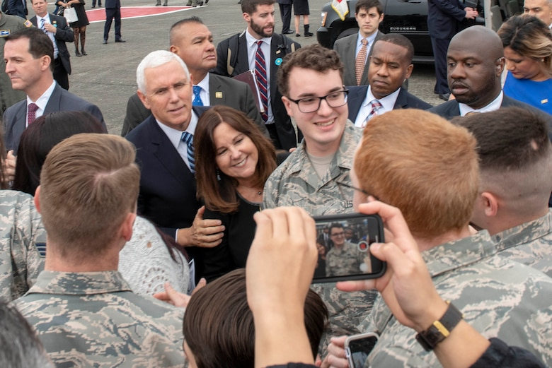 Vice President of the United States Michael R. Pence and his wife, Second Lady Karen Pence, pose for a photo with service members and their families at Yokota Air Base, Japan, Nov. 13, 2018.
