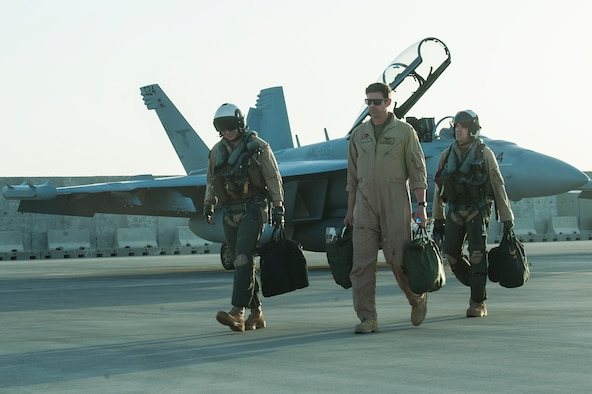 """EA-18G Growler pilots assigned to the Electronic Attack Squadron 135 (VAQ-135) """"Black Ravens"""" arrive at Al Udeid Air Base, Qatar, Oct. 30, 2018. The electronic warfare aircraft has electronic attack, jamming, and satellite communication capabilities as well as communication countermeasures. VAQ-135 will replace VMAQ-2, which operated EA-6B Prowlers. VAQ-135 is deployed to the U.S. 5th Fleet area of operations in support of naval operations to ensure maritime stability and security in the Central Region, connecting the Mediterranean and the Pacific through the western Indian Ocean and three strategic choke points. (U.S. Air Force photo by Tech. Sgt. Christopher Hubenthal)"""
