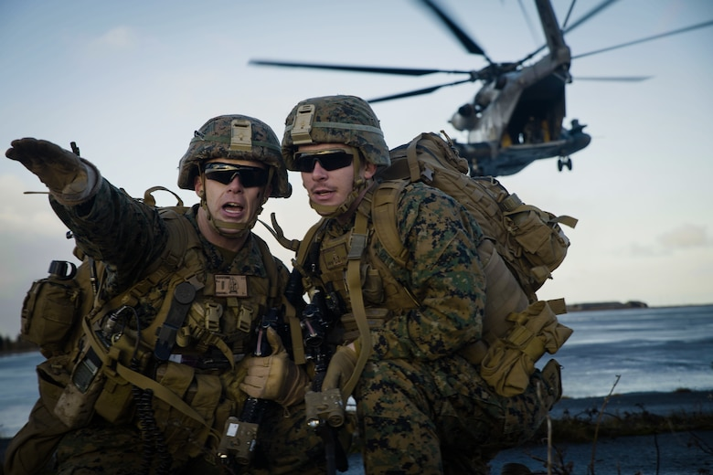 U.S. Marines secure a landing strip after disembarking from Marine Corps CH-53E Super Stallion during air assault training at Keflavik Air Base, Iceland, Oct. 17, 2018, during Exercise Trident Juncture 18.Trident Juncture training in Iceland promoted key elements of preparing Marines to conduct follow-on training in Norway in the later part of the exercise.