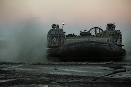 A landing craft air cushion lands on Alvund Beach, Norway during an amphibious landing in support of Trident Juncture 18, Oct. 30, 2018. Trident Juncture provides a unique and challenging environment for Marines and Sailors to rehearse their amphibious capabilities which will result in a more ready and proficient fighting force. The LCACs originated from USS New York and showcased the ability of the Iwo Jima Amphibious Ready Group and the 24th Marine Expeditionary Unit to rapidly project combat power ashore.