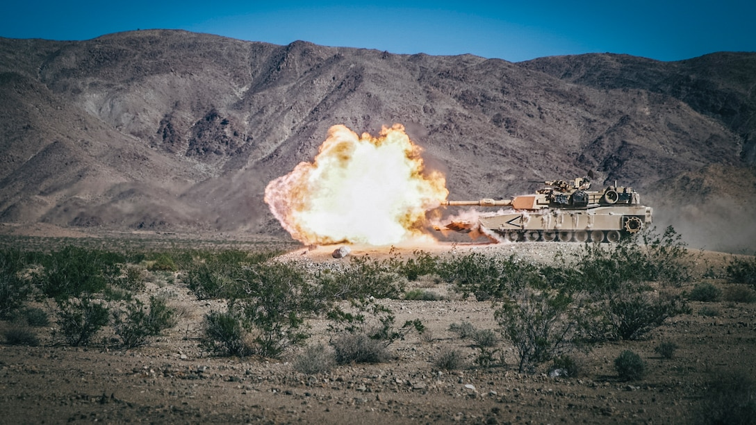 An M1A1 Abrams Main Battle Tank with Battalion Landing Team 3rd Battalion, 5th Marine Regiment, 11th Marine Expeditionary Unit, fires its main gun during a predeployment training exercise at Marine Corps Air Ground Combat Center Twentynine Palms, Calif., Nov. 9, 2018. Darkhorse is preparing for deployment as the ground combat element of the 11th MEU, next year.