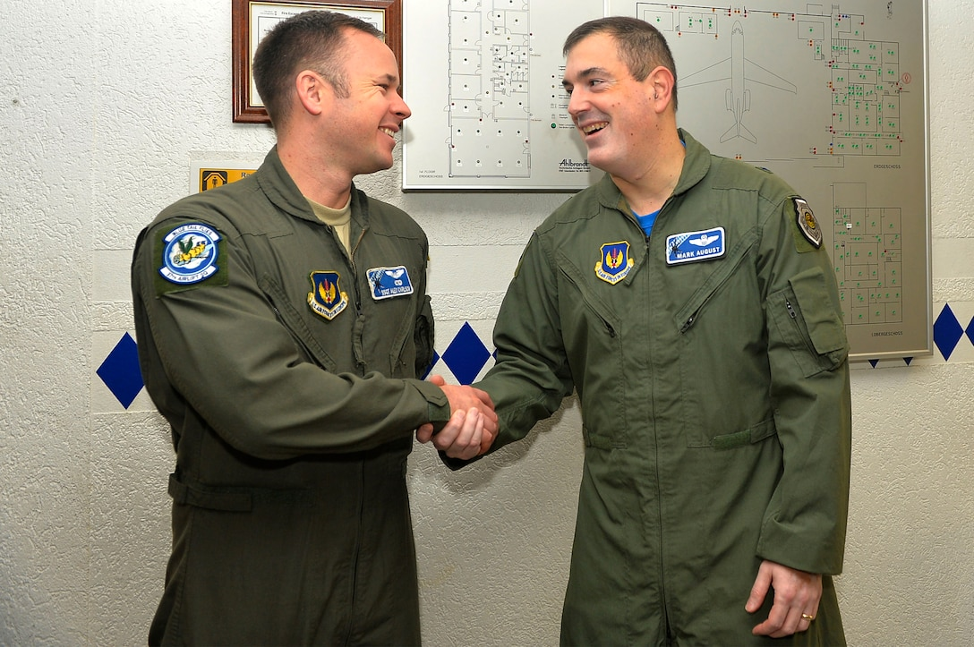 U.S. Air Force Staff Sgt. Alexander Carlson, 37th Airlift Squadron loadmaster, left, receives recognition from U.S. Air Force Brig. Gen. Mark August, 86th Airlift Wing commander, on Ramstein Air Base, Germany, Nov. 9, 2018. Carlson received the honor of being Ramstein's first Airlifter of the Week. (U.S. Air Force photo by Senior Airman Joshua Magbaua)