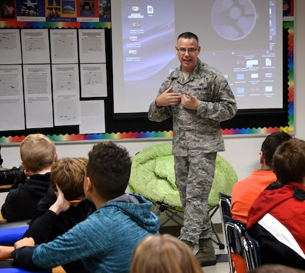 As part of a community outreach project, Master Sgt. Christopher Parr, noncommissioned officer in charge (NCOIC) at the 932nd Airlift Wing's Public Affairs Office, speaks about his vast military experience to Highland Junior High School students November 9, 2018.  He was joined by a 73rd Airlift Squadron pilot, Lt. Col. Brandon Lorton, regarding the C-40 flying mission of the 932nd Airlift Wing, patriotism, and remembering veterans. The public affairs officer, Lt. Col. Stan Paregien, set up a 932nd AW display booth and answered questions about the Air Force Reserve. They handed out some military gear for students to pass around, along with an American flag, and answered student's questions about what it takes to become a pilot and American Airman during an all day event culminating with a final school assembly with local veterans from the community.  (U.S. Air Force photo by Lt. Col. Stan Paregien)