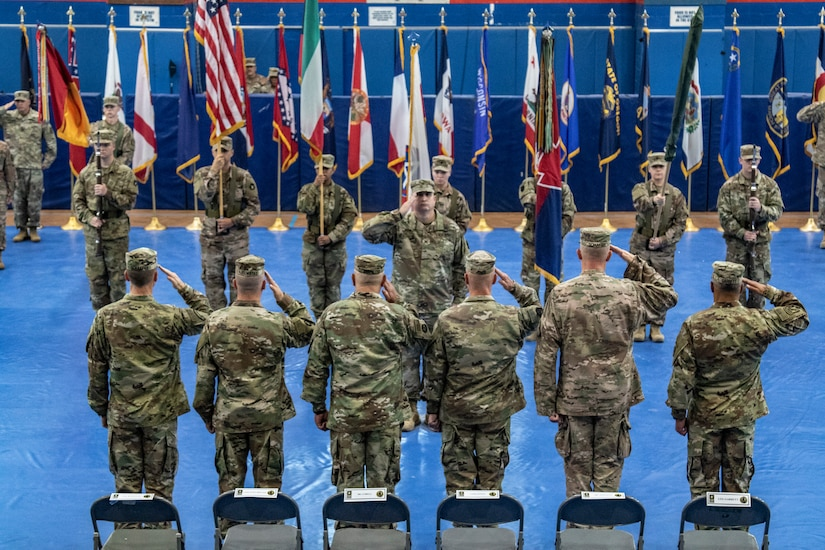 Maj. Gen. Benjamin Corell, 34th Red Bull Infantry Division commanding general and Command Sgt. Maj. Joseph Hjelmstad uncase the Division colors during a transfer of authority ceremony Nov. 12, 2018. The Minnesota National Guard unit's headquarters and headquarters battalion assumed responsibility for the Task Force Spartan mission to from the Pennsylvania National Guard's 28th Infantry Division. The 34th's HHBN is serving as a division headquarters for roughly 10,000 Soldiers conducting theater security operations in the Middle East.