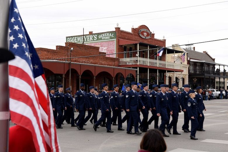 Airmen from the 17th Medical Group march in the Veterans Day Parade in San Angelo, Texas, Nov. 10, 2018. The parade featured veterans, active duty members and marching bands. (U.S. Air Force photo by Senior Airman Randall Moose/Released)