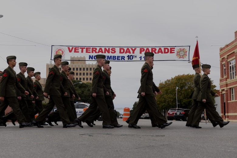 Marines from the Marine Corps Detachment at Goodfellow Air Force Base march in the Veterans Day Parade in San Angelo, Texas, Nov. 10, 2018. The parade represented each branch of the U.S. Armed Forces. (U.S. Air Force photo by Senior Airman Randall Moose/Released)
