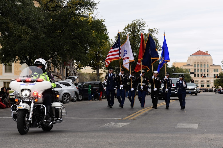 Joint Base Color Guard marches in the Veterans Day Parade in San Angelo, Texas, Nov. 10, 2018. The Color Guard led the parade through the streets of downtown San Angelo. (U.S. Air Force photo by Senior Airman Randall Moose/Released)
