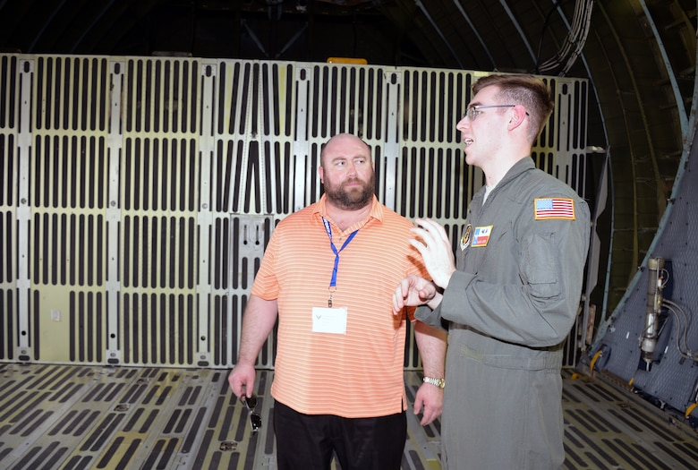 Senior Airman Blake Moore, 68th Airlift Squadron loadmaster, describes the cargo compartment of a C-5M Super Galaxy to Mark Millett, school counselor from Cincinnati, Ohio, at Joint Base San Antonio-Lackland, Texas Nov. 8, 2018.