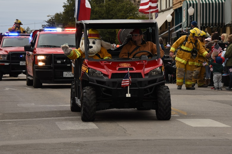 Sparky the Firedog joins the Grape Creek Volunteer Fire Department during the Veterans Day Parade in San Angelo, Texas, Nov. 10, 2018. San Angelo hosted the parade in honor of those serving and those who have served the country. (U.S. Air Force photo by Airman 1st Class Zachary Chapman/Released)