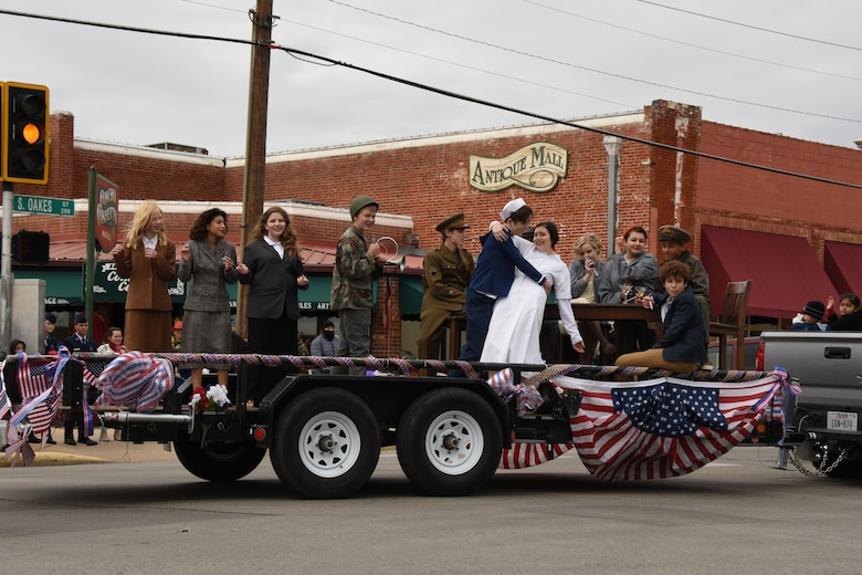 Ambleside School of San Angelo students pay tribute to all veterans with a flashback to the '40s during the Veterans Day Parade in San Angelo, Texas, Nov. 10, 2018. The students dressed as famous figures including Marilyn Monroe, the Andrew Sisters, a Tuskegee Airman, Rosie the Riveter and the V-J Day kiss. (U.S. Air Force photo by Airman 1st Class Zachary Chapman/Released)