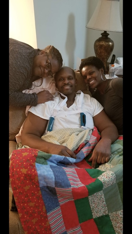 Jackie Bryant, left and Monique Todd, right, sisters of retired Master Sgt. and financial management specialist Daryl McFadden, Center, pose with McFadden after his triple bypass surgery. McFadden underwent heart surgery in January 2018 for obstruction of three vessel coronary arteries. After visiting his doctor for shortness of breath, test results showed his heart had 70-90 percent blockage. (Courtesy photo)