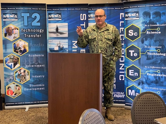 CAPT Oesterreich, NSWC Crane Commanding Officer, delivered opening remarks at the fifth annual Invention and Technology Showcase on Nov. 13. The showcase featured the intellectual property (IP) and innovations of more than 50 NSWC Crane scientists and engineers.